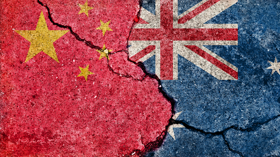 an image of both the Chinese and Australian flags with cracks showing a fractured relationship.