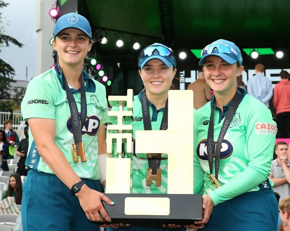 Oval Invincibles' Grace Gibbs, Mady Villiers and Alice Capsey (left-right) lift the inaugural Hundred trophy after the women's final of The Hundred at Lord's (Steven Paston/PA Images). (PA Wire)