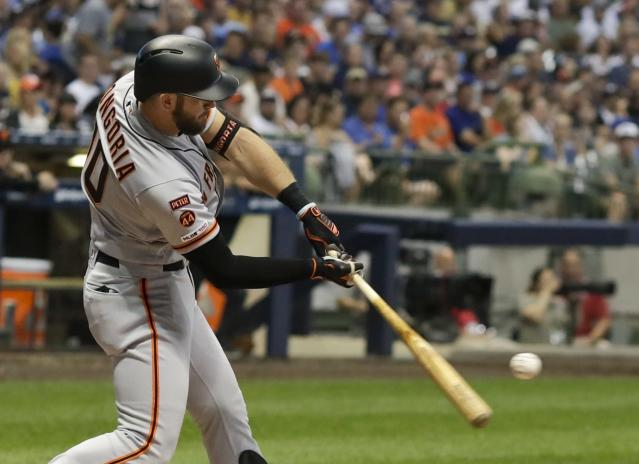 San Francisco Giants' Evan Longoria hits a two run home run during the sixth inning of a baseball game against the Milwaukee Brewers Friday, July 12, 2019, in Milwaukee. (AP Photo/Morry Gash)