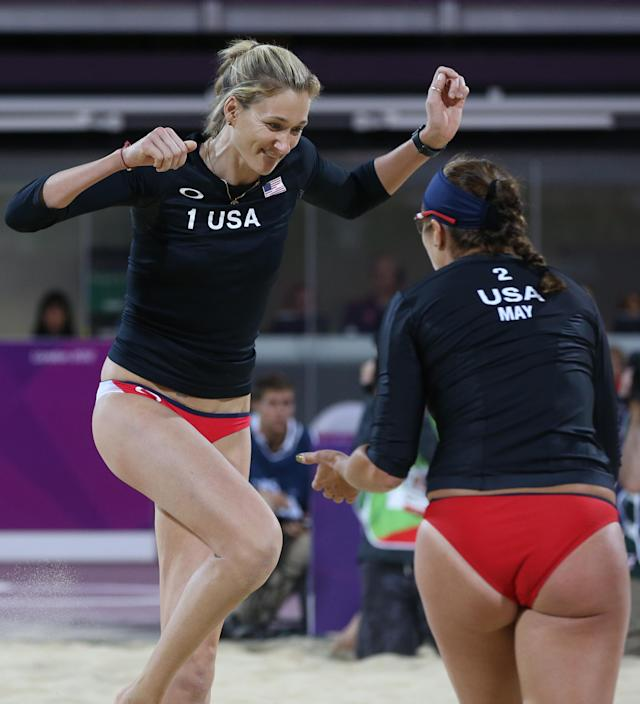 Misty May-Treanor, right, and Kerri Walsh, left, of US celebrate winning a point against Australia in their Beach Volleyball match at the 2012 Summer Olympics, Saturday, July 28, 2012, in London. (AP Photo/Petr David Josek)