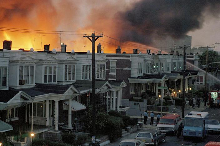 <p>Scores of row houses in Philadelphia burned and 11 people were killed after police dropped two bombs on a home belonging to radical Black liberation organisation MOVE on 13 May, 1985.</p> (AP)