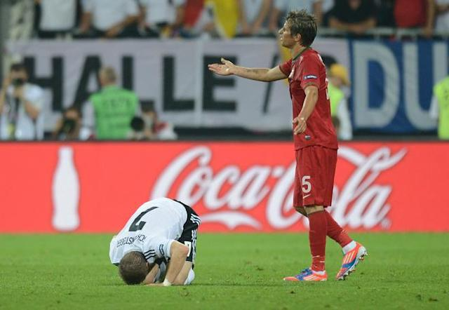 Portuguese defender Fabio Coentrao (L) gestures after fouling German midfielder Bastian Schweinsteiger (L) during the Euro 2012 championships football match Germany vs Portugal on June 9, 2012 at the Arena Lviv. AFP PHOTO / JEFF PACHOUDJEFF PACHOUD/AFP/GettyImages