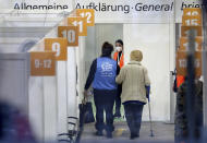 A person is guided in a new coronavirus, COVID-19, vaccination center at the 'Erika-Hess-Ice-Stadium' in Berlin, Germany, Thursday, Jan. 14, 2021. The first doses of the Moderna vaccine are distributed at that vaccination center in Berlin. (AP Photo/Michael Sohn)