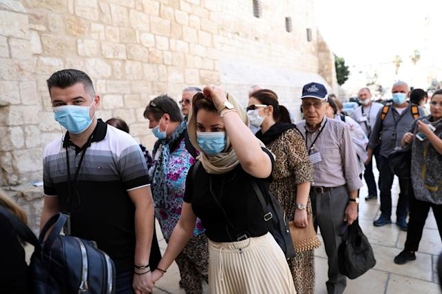 People are pictured wearing masks in Bethlehem on 5 March. (Getty Images)