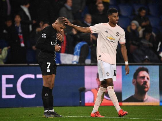 Marcus Rashford commiserates Kylian Mbappe at full-time (AFP/Getty Images)