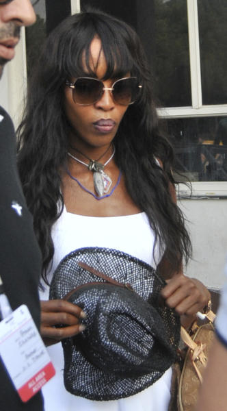 FILE - In this Nov. 4, 2012 file photo, British supermodel Naomi Campbell arrives at Jodhpur, India. Naomi Campbell is pulling out all the stops to celebrate the birthday of her boyfriend, Russian billionaire Vladimir Doronin, in the palaces of western India. The birthday celebration kicked off on Tuesday night, Nov. 6, 2012. (AP Photo/File)