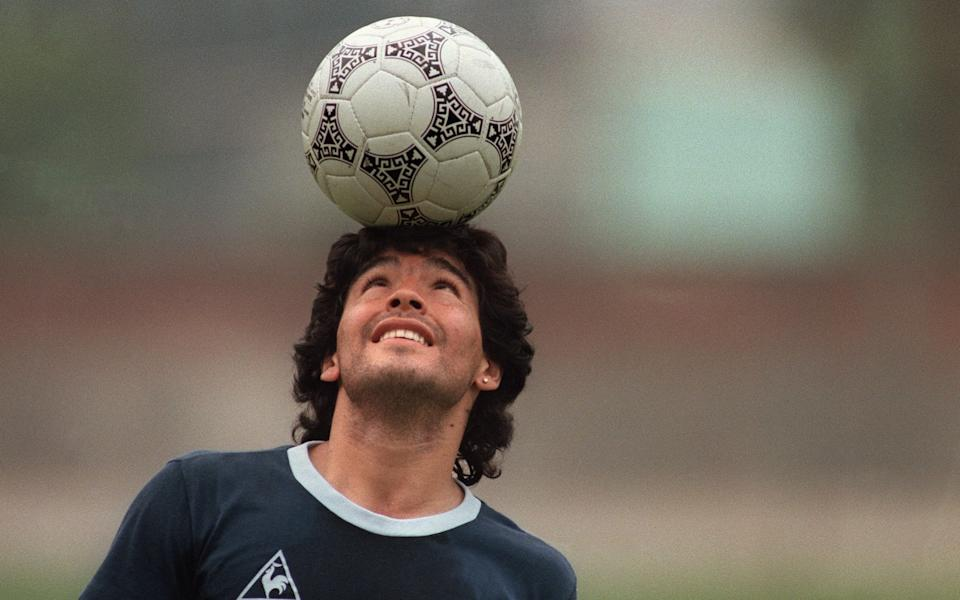 Argentine football star Diego Maradona, wearing a diamond earring - AFP