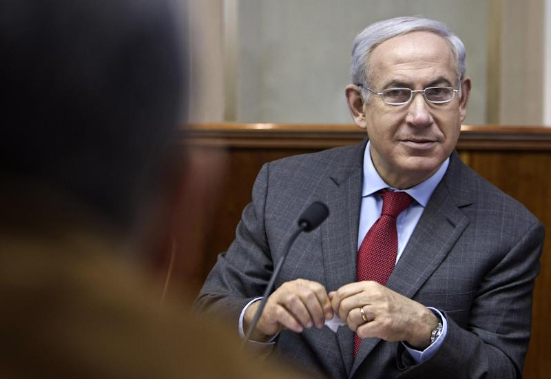 Israeli Prime Minister Benjamin Netanyahu convenes the weekly cabinet meeting in Jerusalem, Sunday, Feb. 26, 2012. Netanyahu says Iran's nuclear program will take center stage in his upcoming talks with North American leaders. (AP Photo/Jim Hollander, Pool)