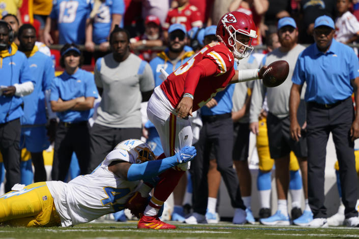Kansas City Chiefs quarterback Patrick Mahomes (15) is tackled by Los Angeles Chargers' Kyzir White (44) during the first half of an NFL football game, Sunday, Sept. 26, 2021, in Kansas City, Mo. (AP Photo/Ed Zurga)