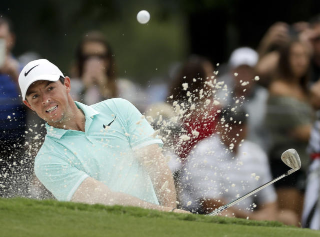 FILE - In this Aug. 9, 2017, file photo, Rory McIlroy of Northern Ireland, hits from the bunker on the ninth hole during a practice round at the PGA Championship golf tournament at the Quail Hollow Club, in Charlotte, N.C. McIlroy plans to play at least seven tournaments leading into the Masters next year. (AP Photo/Chris Carlson, File)
