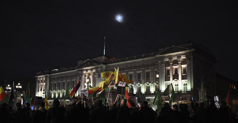 Demonstrators against the NATO summit and U.S. President Donald Trump's visit, gather at Buckingham Palace in London, Tuesday, Dec. 3, 2019. Trump and his NATO counterparts were gathering in London Tuesday to mark the alliance's 70th birthday amid deep tensions as spats between leaders expose a lack of unity that risks undermining military organization's credibility. (AP Photo/Alberto Pezzali)