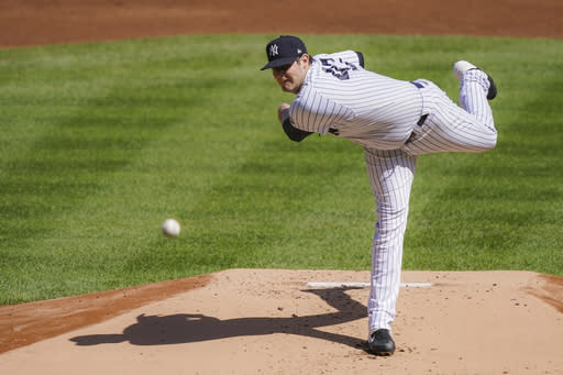 New York Yankees starting pitcher Jordan Montgomery throws in the first inning of a baseball game against the Baltimore Orioles, Saturday, Sept. 12, 2020, in New York. (AP Photo/John Minchillo)