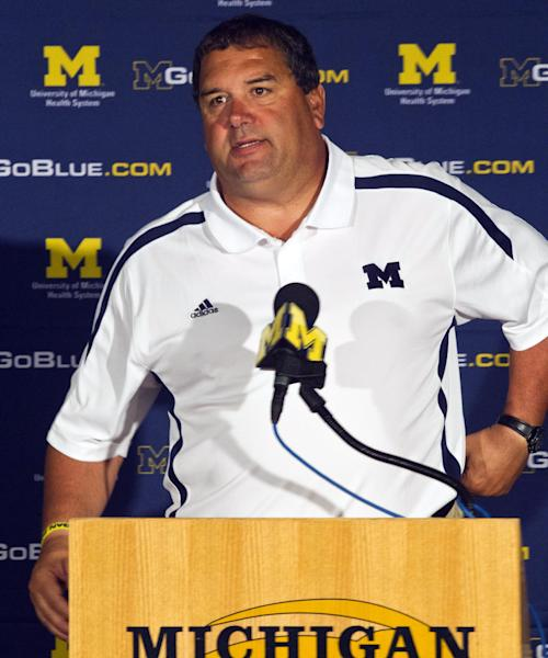 FILE - In this Aug. 12, 2012, file photo, Michigan head coach Brady Hoke answers questions during a news conference at the NCAA college football team's media day in Ann Arbor, Mich. Michigan is scheduled to play Alabama for just the fourth time on Saturday, Sept. 1, at Cowboys Stadium in Arlington, Texas, despite having combined for 1,709 wins and 25 national titles. (AP Photo/Tony Ding, File)