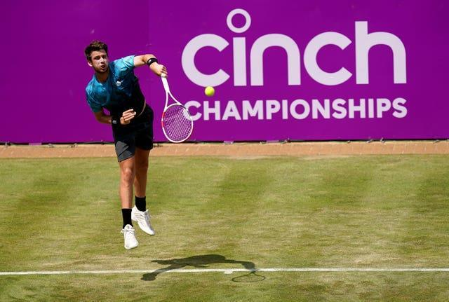 Cameron Norrie serves during his victory