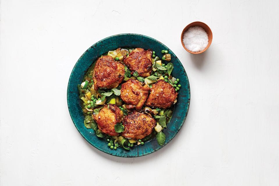 """We'd go to our graves defending low-maintenance, quick-cooking, always-flavorful chicken thighs as the best part of the bird. This recipe harnesses their power by using the fat that renders when they're seared on the stove to soften thick rounds of leeks and spring peas for a built-in side. Leave the chicken uncovered when it goes into the oven so the skin crisps up while cooking. <a href=""""https://www.epicurious.com/recipes/food/views/roast-chicken-thighs-with-peas-and-mint?mbid=synd_yahoo_rss"""" rel=""""nofollow noopener"""" target=""""_blank"""" data-ylk=""""slk:See recipe."""" class=""""link rapid-noclick-resp"""">See recipe.</a>"""