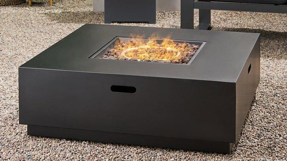 """Overstock buyers said this """"cozy"""" outdoor fire table exceeded expectations."""