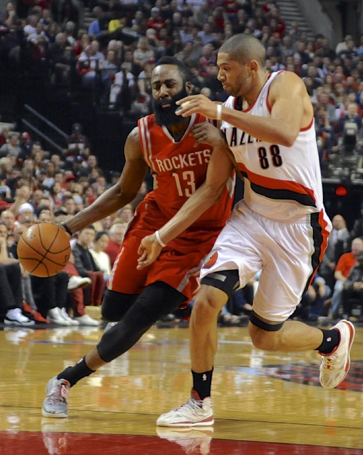 Houston Rockets' James Harden (13) drives against Portland Trail Blazers' Nicolas Batum (88) during the first half of game six of an NBA basketball first-round playoff series game in Portland, Ore., Friday May 2, 2014. (AP Photo/Greg Wahl-Stephens)
