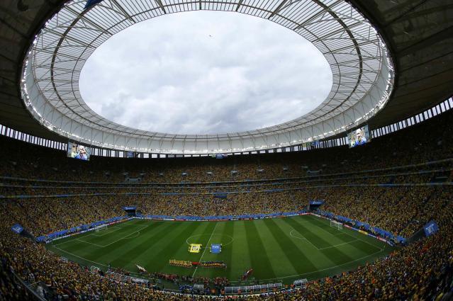 A general view of the stadium is seen as the national anthems are sung before the start of the 2014 World Cup third-place playoff between Brazil and the Netherlands at the Brasilia national stadium in Brasilia July 12, 2014. REUTERS/Ruben Sprich (BRAZIL - Tags: SOCCER SPORT WORLD CUP)