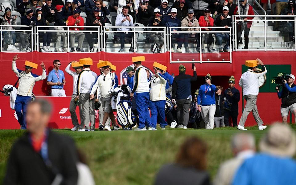 Team Europe arrive with their cheese hats - PA