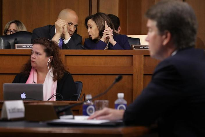 """<span class=""""element-image__caption"""">Senators Cory Booker and Kamala Harris confer as the then supreme court nominee Brett Kavanaugh testifies on Capitol Hill in September 2018.</span> <span class=""""element-image__credit"""">Photograph: Chip Somodevilla/Getty Images</span>"""