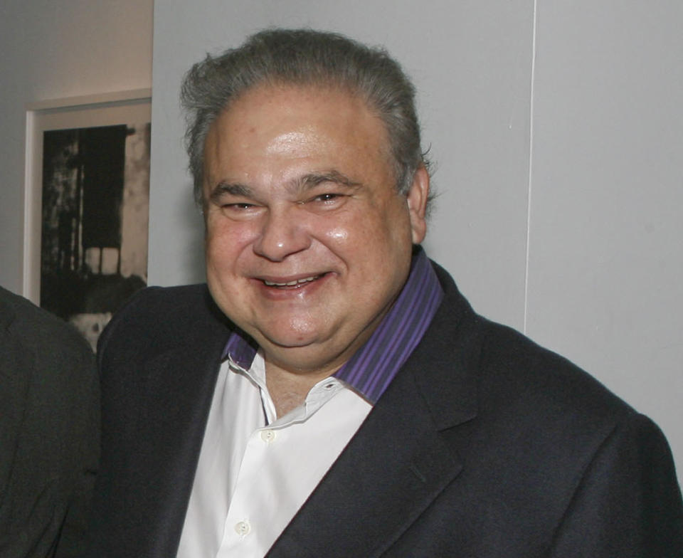 """<p> FILE - This Jan. 31, 2010, file image released by Miami Dade College shows Dr. Salomon Melgen, posing for a photo at the book signing of """"Growing American Roots"""", a book by Sen. Robert Menendez, D-N.J., at the college in Miami. Topping Medicare's list of highest paid physicians from it's claims database was Florida ophthalmologist Salomon Melgen, whose relationship with Sen. Robert Menendez, D-N.J., made headlines last year after news broke that the lawmaker used the doctor's personal jet for trips to the Dominican Republic. Medicare paid Melgen $20.8 million. (AP Photo/Miami Dade College, Phil Roche, File) </p>"""