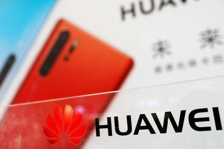 FILE PHOTO: The logo of Huawei is seen at its showroom in Shenzhen