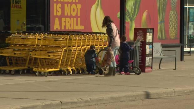 A woman and two children were seen making their way to pick up their groceries from the new No Frills in Ottewell.