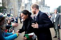 <p>During their first trip to Wales as a couple, Prince Harry helped guide his bride-to-be around the crowds as they visited royal fans, January 2018.</p>