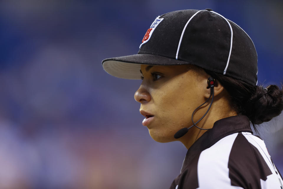 Maia Chaka in NFL referee hat.