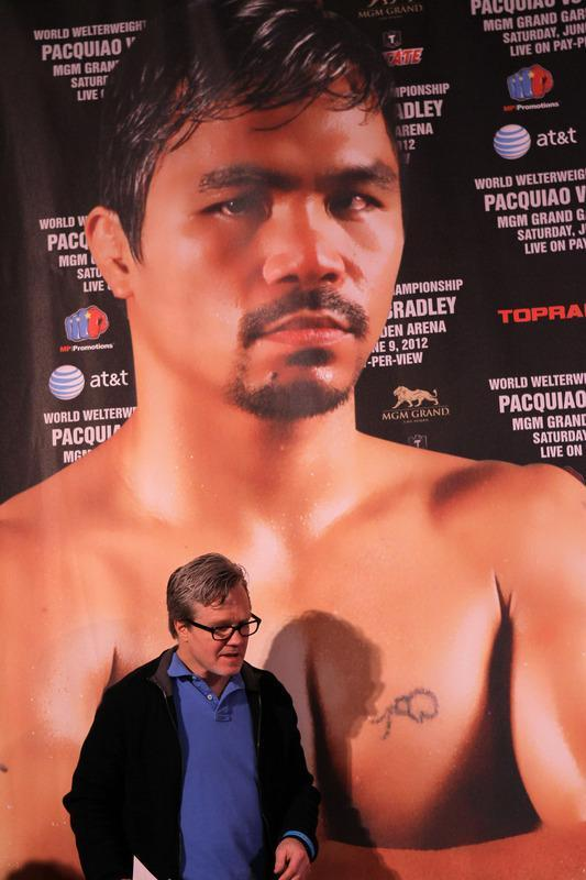 BEVERLY HILLS, CA - FEBRUARY 21: Trainer Freddie Roach walks beneath a photo photo of his fighter Manny Pacquiao at a press conference announcing Pacquiao's upcoming World Boxing Organization welterweight championship fight against Timothy Bradley at The Beverly Hills Hotel on February 21, 2012 in Beverly Hills, California. (Photo by Stephen Dunn/Getty Images)