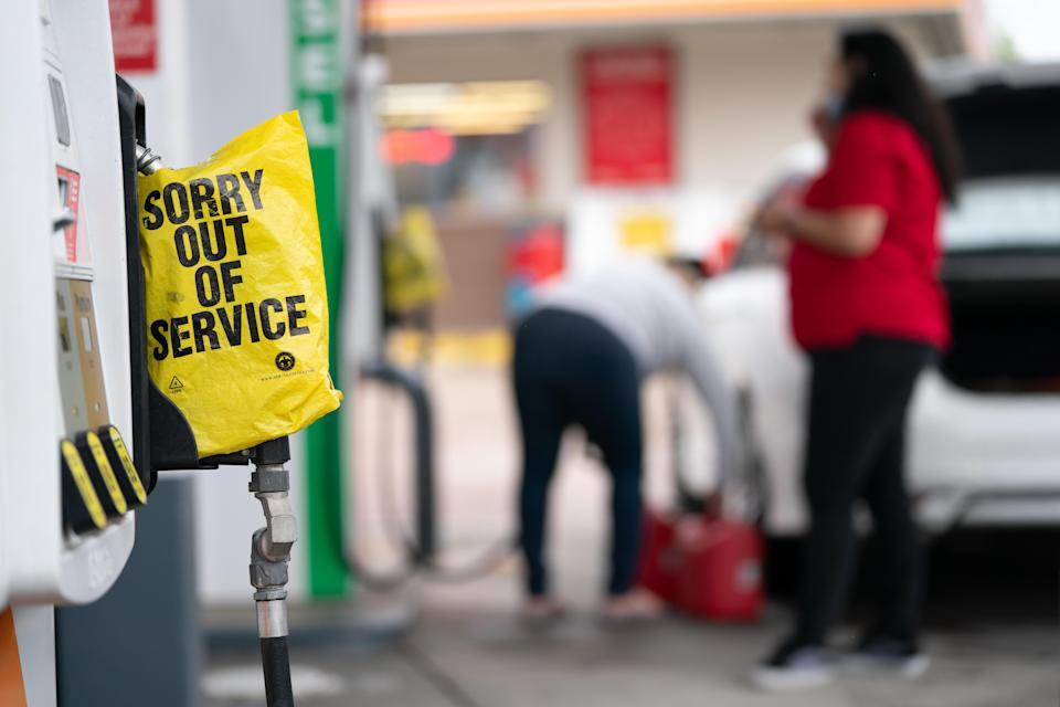 An out-of-service bag covers a pump handle at a gas station on May 12, 2021, in Fayetteville, North Carolina. / Credit: Sean Rayford / Getty
