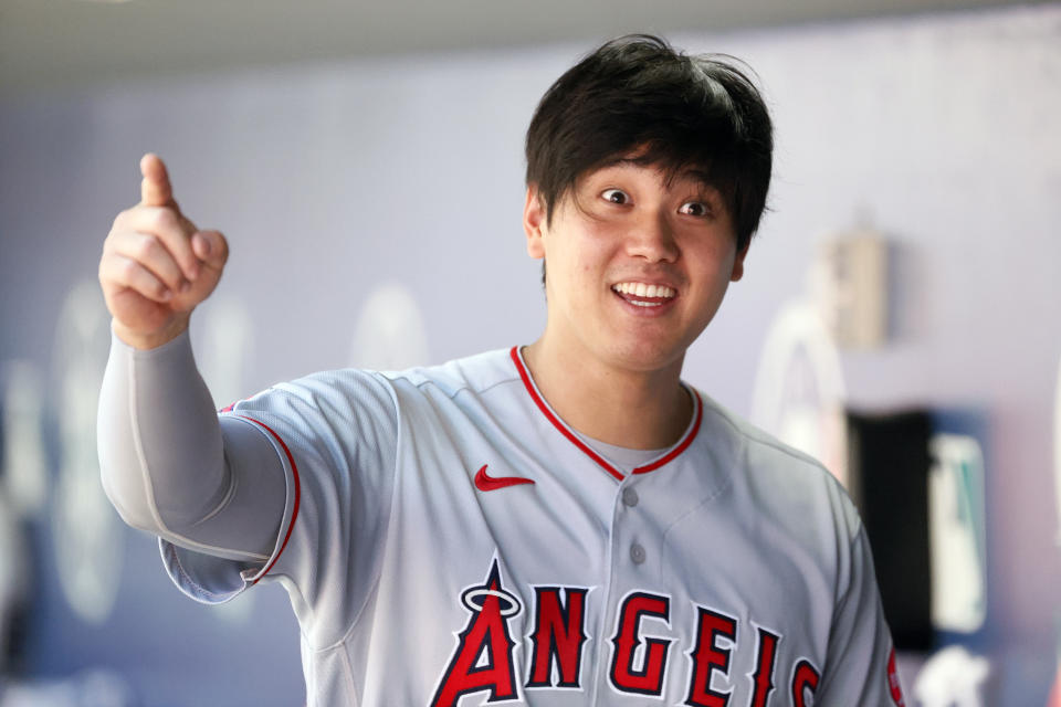 SEATTLE, WASHINGTON - JULY 11: Shohei Ohtani #17 of the Los Angeles Angels looks on in the dugout during the game against the Seattle Mariners at T-Mobile Park on July 11, 2021 in Seattle, Washington. (Photo by Steph Chambers/Getty Images)