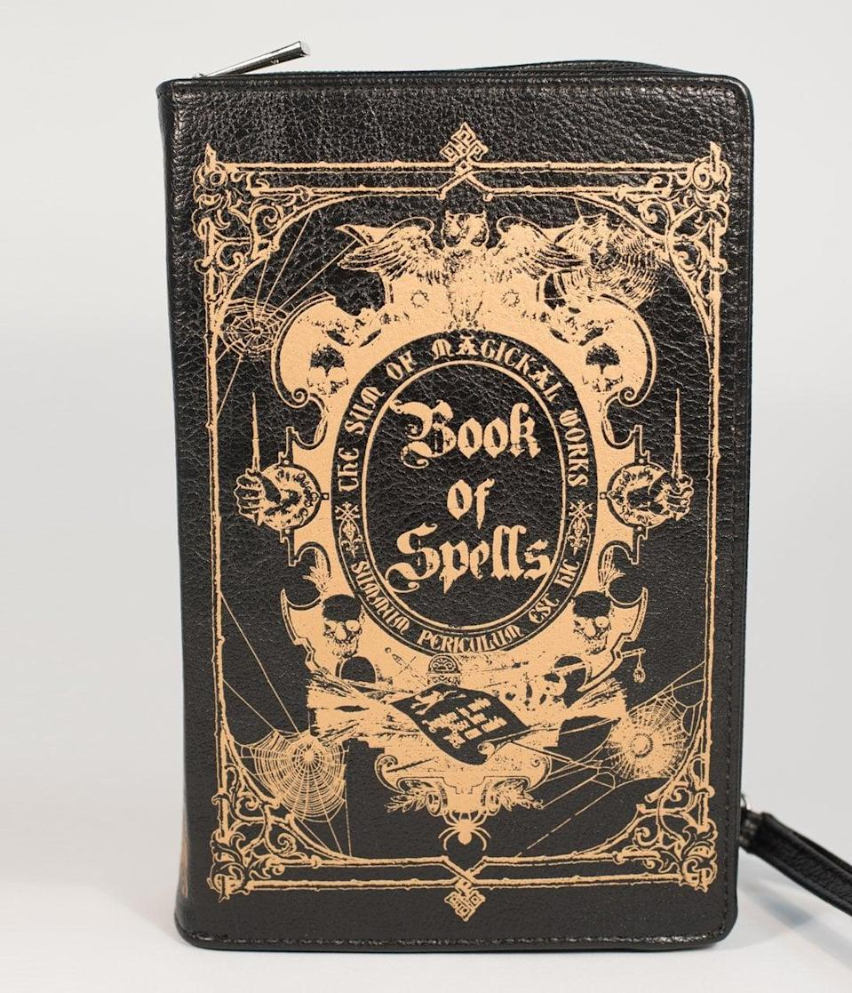 <p>Everyone will do a double-take before touching this <span>Black and Gold Book of Spells Crossbody Purse</span> ($48).</p>
