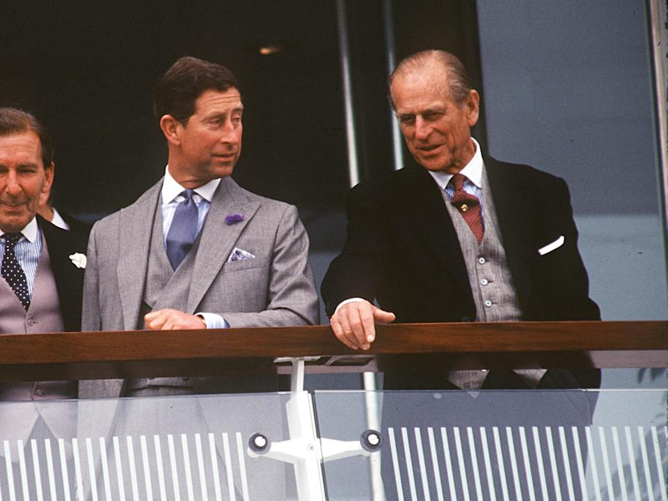 Prince Charles and Prince Philip watch races at the Derby