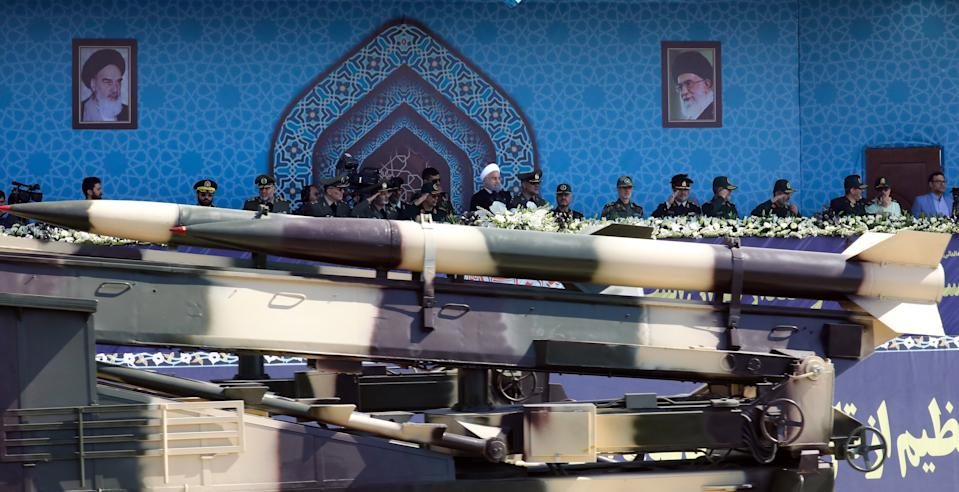An Iranian medium range missile Zelzal passes by Iranian President Hassan Rouhani (C)   during the annual military parade marking the anniversary of the outbreak of its devastating 1980-1988 war with Saddam Hussein's Iraq, on September 22, 2017 in Tehran. Rouhani vowed that Iran would boost its ballistic missile capabilities despite criticism from the United States and also France. / AFP PHOTO / str        (Photo credit should read STR/AFP via Getty Images)