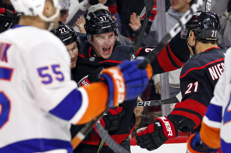 Carolina Hurricanes' Andrei Svechnikov (37), of Russia, celebrates his goal against the New York Islanders with teammates Brett Pesce (22) and Nino Niederreiter (21), of Switzerland, during the first period of an NHL hockey game in Raleigh, N.C., Sunday, Jan. 19, 2020. (AP Photo/Karl B DeBlaker)