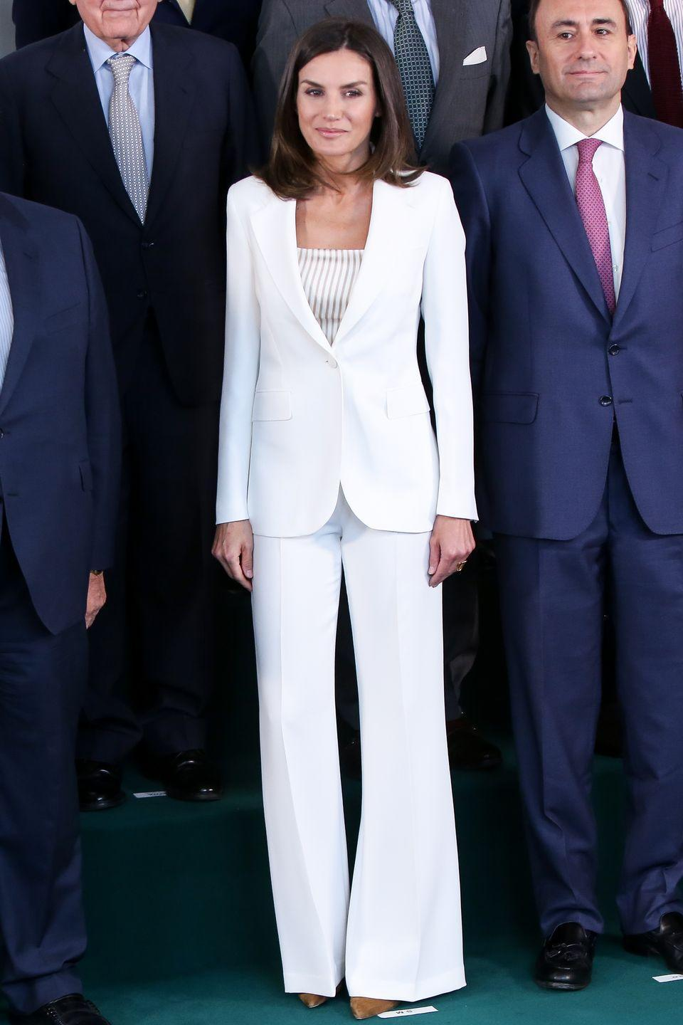 <p>In Madrid, the Queen wore a sleek white pantsuit while visiting FAD (Foundation Against Drug Addiction). </p>