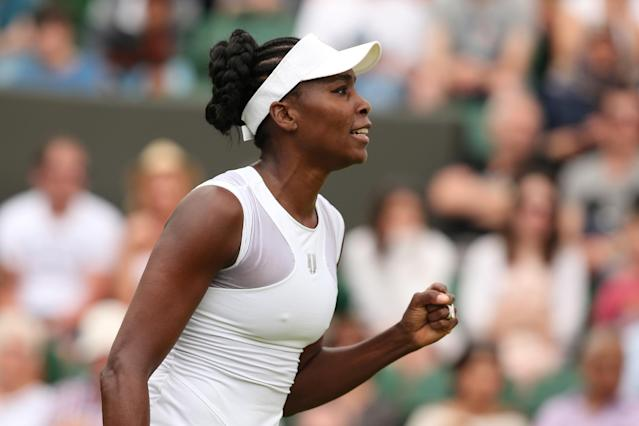 US player Venus Williams celebrates beating Spain's Maria-Teresa Torro-Flor during their women's singles first round match on day one of the 2014 Wimbledon Championships on June 23, 2014 (AFP Photo/Andrew Yates)
