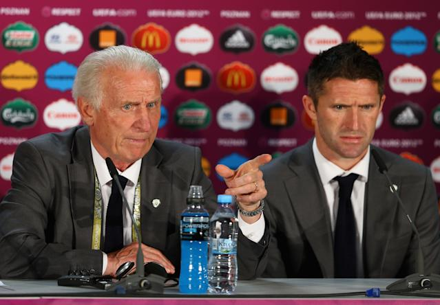 POZNAN, POLAND - JUNE 10: In this handout image provided by UEFA, Coach Giovanni Trapattoni and Robbie Keane (R) of the Republic of Ireland talk to the press during a UEFA EURO 2012 press conference after the UEFA 2012 Group C match between Republic of Ireland and Croatia on June 10, 2012 in Poznan, Poland. (Photo by Handout/UEFA via Getty Images)