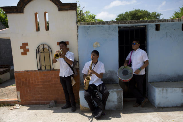 <p>Musicians stand in front of tombs as they play during the burial of 64-year-old Reynalda Matus inside Miercoles Santo Cemetery, in Juchitan, Oaxaca state, Mexico, Saturday, Sept. 9, 2017. Matus was killed when the pharmacy where she worked nights collapsed during Thursday's massive earthquake. (AP Photo/Rebecca Blackwell) </p>
