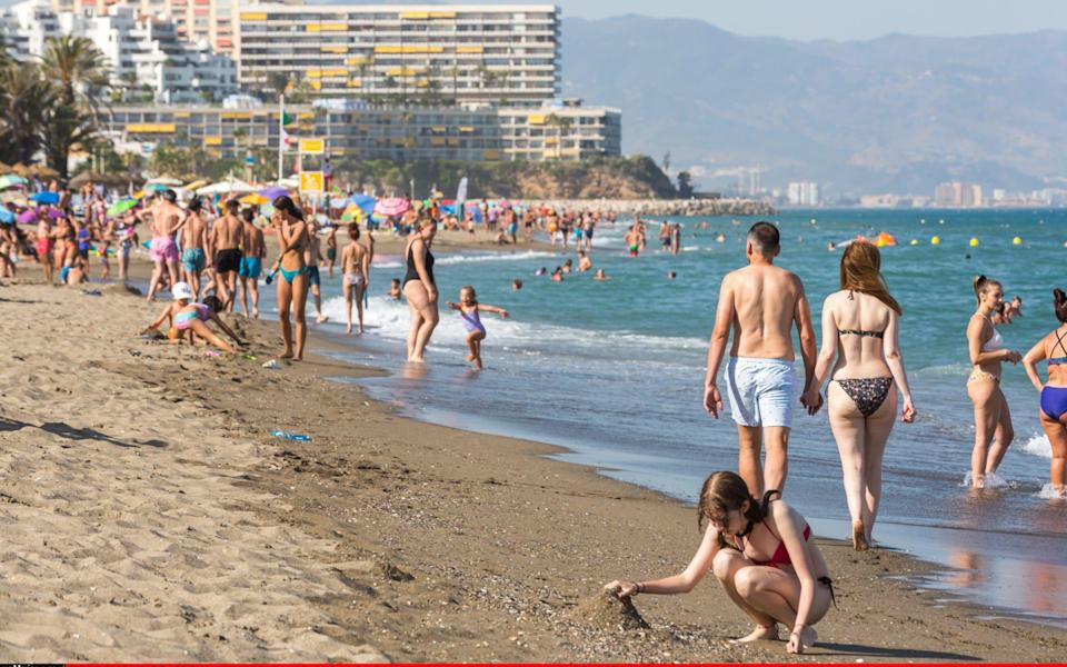 Holidaymakers enjoying the beaches of Torremolinos, Malaga, this summer - Getty