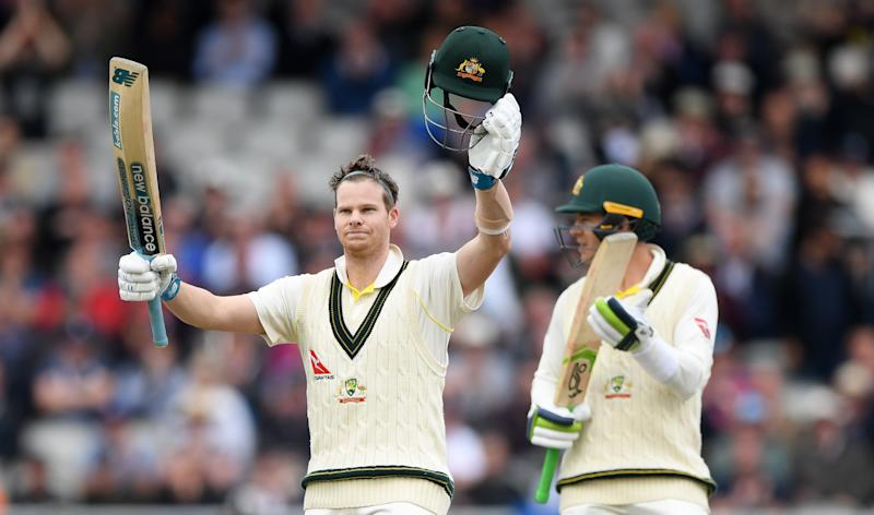 MANCHESTER, ENGLAND - SEPTEMBER 05: Australia batsman Steve Smith celebrates after reaching his century as Tim Paine applauds during day two of the 4th Ashes Test Match between England and Australia at Old Trafford on September 05, 2019 in Manchester, England. (Photo by Stu Forster/Getty Images)