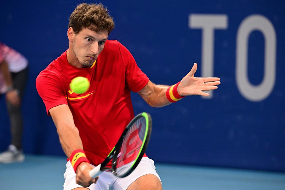 Spain's Pablo Carreno Busta returns the ball to Russia's Daniil Medvedev during their Tokyo 2020 Olympic Games men's singles quarterfinal tennis match at the Ariake Tennis Park in Tokyo on July 29, 2021. (Photo by Vincenzo PINTO / AFP) (Photo by VINCENZO PINTO/AFP via Getty Images)