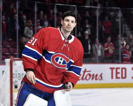 Mar 12, 2019; Montreal, Quebec, CAN; Montreal Canadiens goalie Carey Price (31) prepares to throw pucks to the crowd after being named first star of the game after the game against the Detroit Red Wings at the Bell Centre. Price becomes the winningest goalie in franchise history. Mandatory Credit: Eric Bolte-USA TODAY Sports