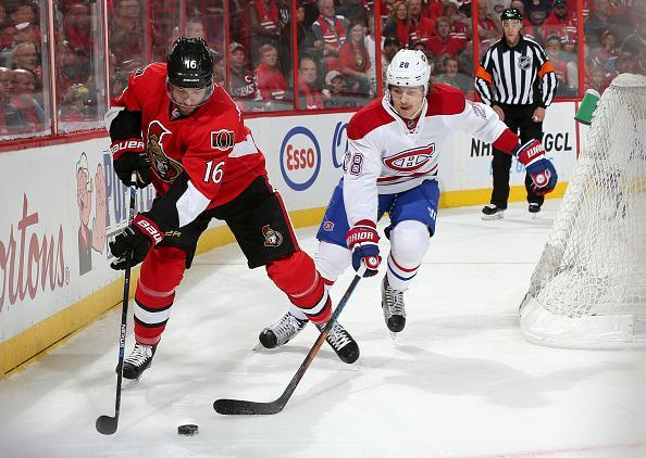 OTTAWA, ON - OCTOBER 11: Clarke MacArthur #16 of the Ottawa Senators controls the puck against Nathan Beaulieu #28 of the Montreal Canadiens at Canadian Tire Centre on October 11, 2015 in Ottawa, Ontario, Canada. (Photo by Andre Ringuette/NHLI via Getty Images)