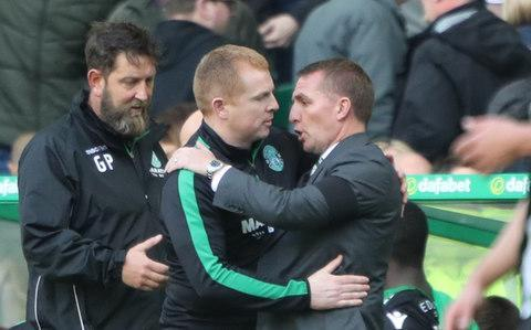 <span>Rodgers welcomed Neil Lennon back to Celtic on Saturday afternoon</span> <span>Credit: PA </span>