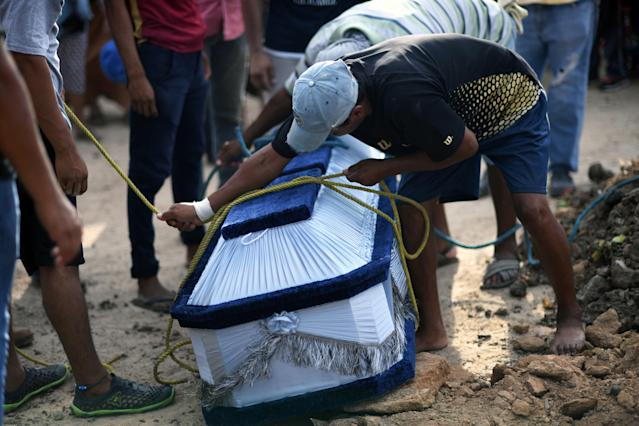 <p>The coffin of 85-year-old Casimiro Rey, one of the victims of an 8.2 magnitude earthquake that hit Mexico's Pacific coast overnight, is prepared for burial during his funeral on Sept. 8, 2017 in Juchitan de Zaragoza, state of Oaxaca. (Photo: Pedro Pardo/AFP/Getty Images) </p>