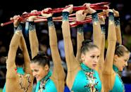 The Belarusian team perform in the 3 Hoops and 2 Clubs rotation in the Group All-Around Final6 of the Beijing 2008 Olympic Games on August 24, 2008 in Beijing, China.