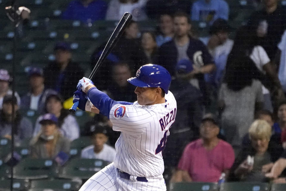 Chicago Cubs' Anthony Rizzo follows through on an RBI triple off Philadelphia Phillies starting pitcher Zack Wheeler during the second inning of a baseball game Wednesday, July 7, 2021, in Chicago. Joc Pederson scored. (AP Photo/Charles Rex Arbogast)