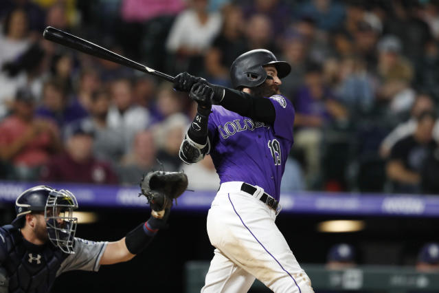 Colorado Rockies' Charlie Blackmon watches his solo home run next to San Diego Padres catcher Austin Allen during the sixth inning of a baseball game Thursday, June 13, 2019, in Denver. (AP Photo/David Zalubowski)